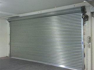 The three most common garage door types houston tx for Houston garage door repair